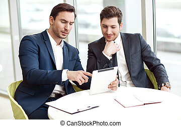 Business partners sitting at the table