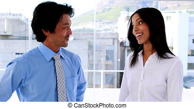 Business partners smiling chatting