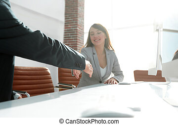 business partners stretching out their hands for a handshake