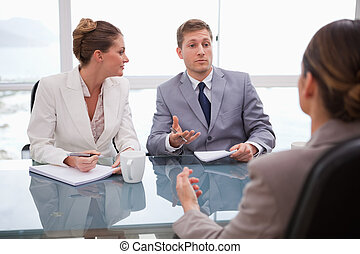 Business partners talking with lawyer