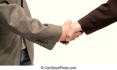 Business Partners - Two men in suits shake hands as a symbol...