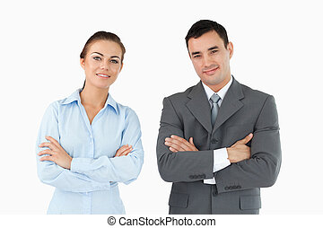 Business partners with arms folded