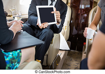 Business Partners Working In Private Jet