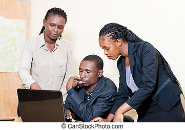 Business partners working on a laptop in the office.