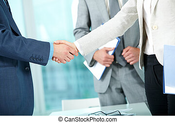 Photo of handshake of business partners after striking deal on background of man