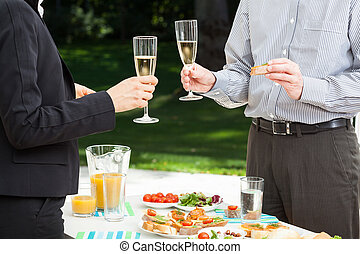 Business party in the garden - Business people are...