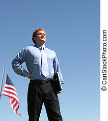 Business patriotism - business man in blue shirt standing in...
