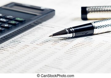 business pen, calculator on financial chart