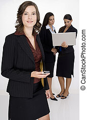 Business People - A young woman executive standing in front...