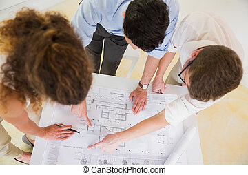 Business people analyzing blueprint