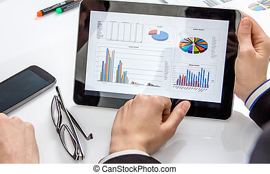 Business people analyzing documents in a meeting