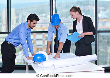 business people and construction engineers on meeting