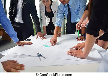 business people and engineers on meeting
