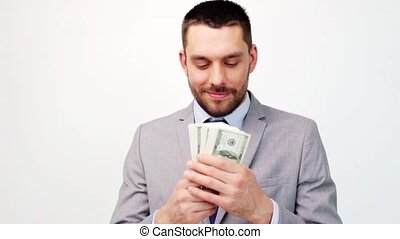 happy businessman with lot of dollar money - business,...