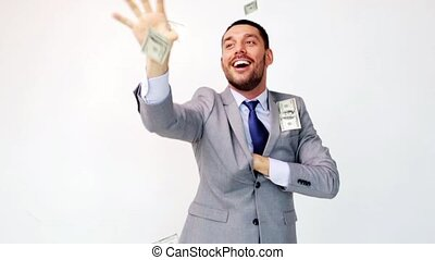 happy businessman with packets of dollar money - business,...