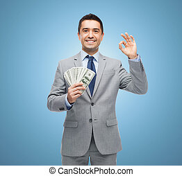 smiling businessman with american dollar money - business, ...