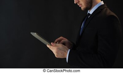 businessman in suit working with tablet pc
