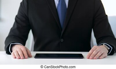 close up of businessman with tablet pc at office - business,...