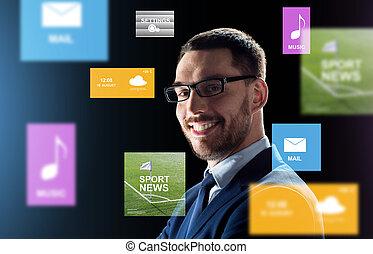 smiling businessman in glasses over black