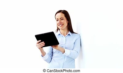 smiling businesswoman with tablet pc computer