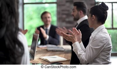Business people applaude at the office meeting - Applauding...