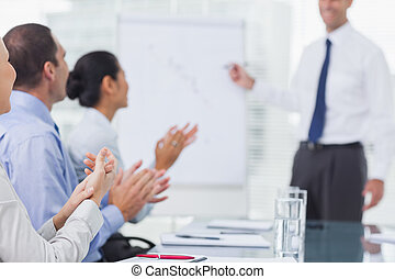 Business people applauding after presentation