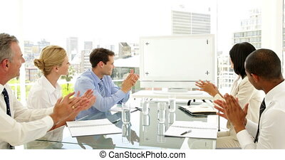 Business people applauding at a meeting
