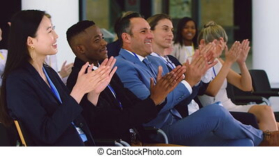 Side view of diverse Business people applauding in a business seminar. They are attending a business seminar 4k