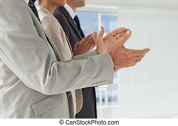 Business people applauding together