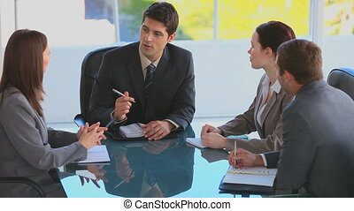 Business people appointing a next meeting in an office