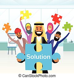 Business People Arab Group Hold Jigsaw Puzzle Piece Concept of Solution Arabic