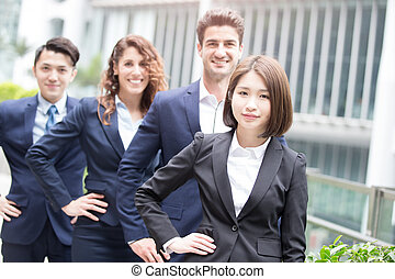 business people team arms akimbo in hongkong