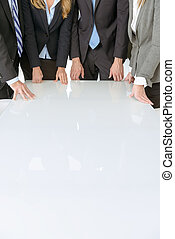 Business people around table
