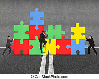 Business People Assembling Jigsaw Puzzle - Business people...
