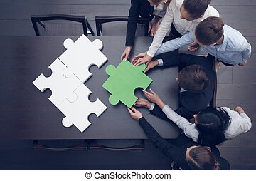Business people assembling puzzle - Group of business people...