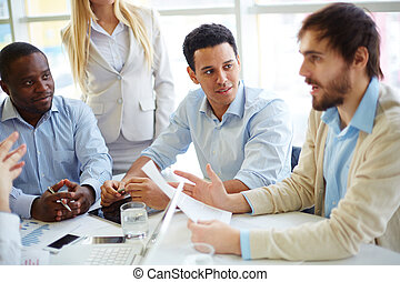 Business people at briefing - Business people having meeting
