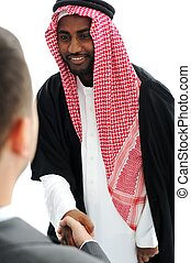 Business people at Middle East shaking hands