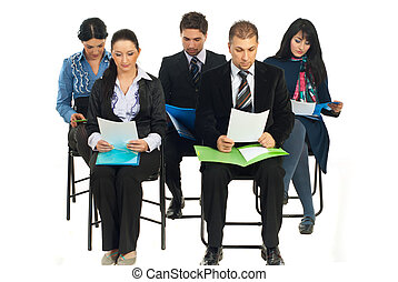 Business people at seminar reading