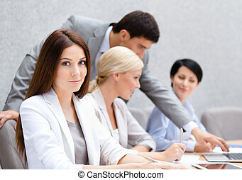 Business people at the conference discuss current issues at the modern office building. Team