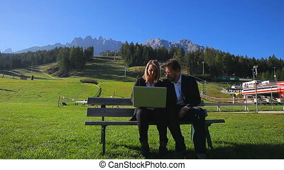Business people at work in mountain