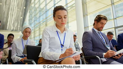 Business people attending a business seminar 4k