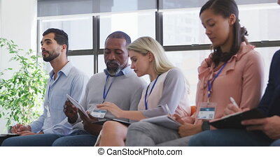 Business people attending to a meeting in conference room