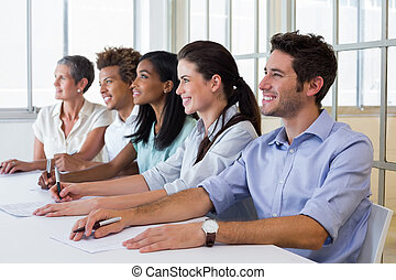Business people attentive at presentation