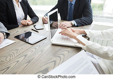 Business people brainstorming at office desk, analyzing ...