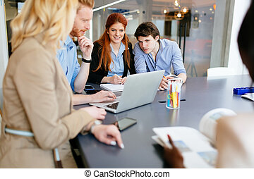 Business people brainstorming in office at desk