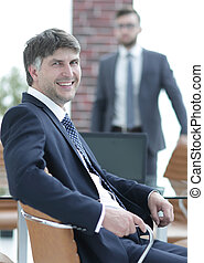 Businessman sitting in an empty conference room