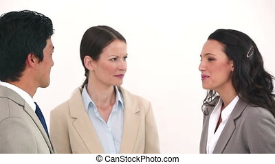 Business people chatting against white background