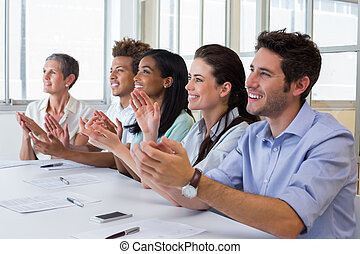 Business people clapping after presentation