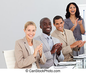 Business people clapping at a presentation - Young Business...