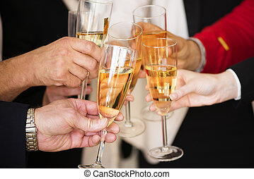Business people clinking champagne
